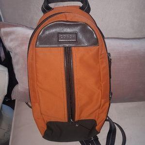 🦄 3/$60 Coach orange brown leather sling backpack